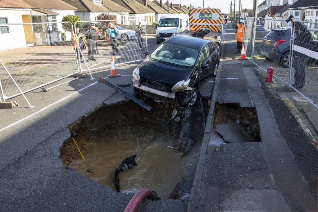 Storm Ciara and underground water leak causes sink hole in Brentwood Essex which swallows Toyota car, Brentwood, Essex, UK