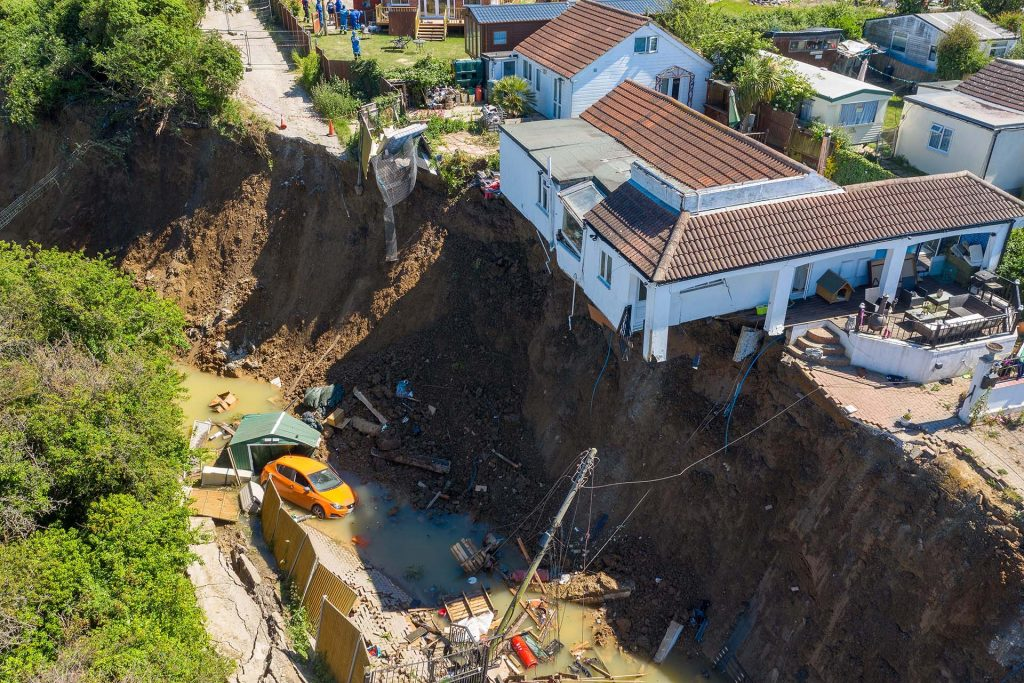 Cliff collapse in Kent leaves house hanging over fallen cliff