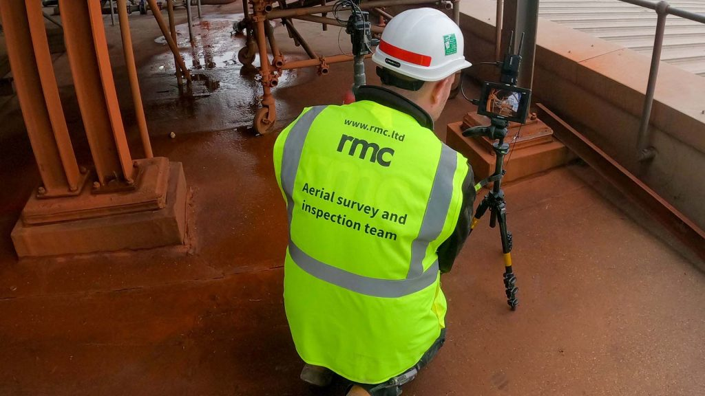 RMC operative inspecting industrial pipework